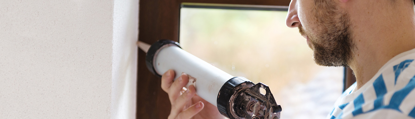 caulking windows to seal air leaks